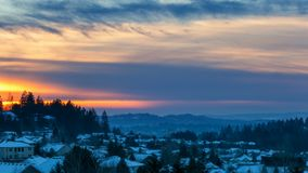 Time lapse of sunset over suburban residential homes in Happy Valley Oregon on a snowy winter evening 4k. Time lapse movie of beautiful sunset over suburban stock video footage