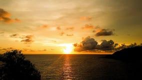 Time lapse sunset at Promthep Cape Phuket Thailand. Tropical sunset time lapse scene in the sea. Phuket Lam Phromthep. Sun and cloud stock footage