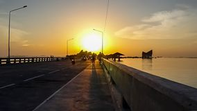 Time lapse of sunset sky at Koh Loy island with silhouette of traffic on bridge. Sriracha city, Chonburi, Thailand stock video