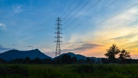 Time lapse of sunset sky with silhouette electricity pole stock footage