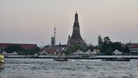 Time lapse of sunset sky with Wat Arun and Chao Phra Ya river (Day to night scene). Time lapse of sunset sky with Wat Arun and Chao Phra Ya river, Bangkok stock video footage