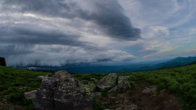 Time Lapse Sunset storm rolls in over Round Bald, North Carolina. A time lapse of a storm and sunset moving into the valley below the Roan Highlands in eastern stock footage