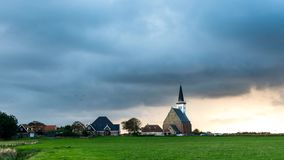 Time lapse of sunset on Texel with church stock footage