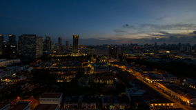 Time lapse of sunset to blue hour over Kampong Glam with Singapore cityscape