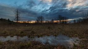 Time lapse of sunset with water reflection in Foster Floodplain Natural Area in Portland OR stock video