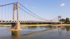 Time lapse at suspension bridge over the river Loire stock footage