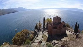 Time lapse of Sv Jovan Kaneo church in Ohrid with lake in background, Macedonia