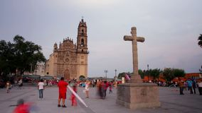 Time lapse of Tepotzotlan Church and a cross. Tepotzotlan, Mexico-CIRCA June 2017: Time lapse of Tepotzotlan Church and a cross. Most mexicans are Catholics due stock video footage