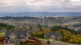 Time Lapse of thick moving clouds and sun rays over city of Happy Valley Oregon residential suburbs homes landscape 4k stock video