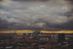 Time lapse tilt shift shooting of fast moving storm clouds over city. Time lapse tilt shift shooting of fast moving storm clouds during dramatic scenery sunset stock footage