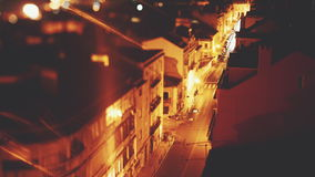 Time lapse tilt shift shooting from high above of night street. Time lapse tilt shift shooting from high above of night narrow street in residential European stock video footage