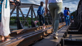 Time-lapse of Tourists on the Bridge River Kwai in Kanchanaburi, Thailand. KANCHANABURI, THAILAND - June 24, 2017: Time-lapse of Tourists on the Bridge River stock footage