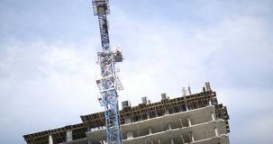 Time-lapse, tower crane. Construction of a residential home. Time-lapse, tower crane. Construction. Construction of a residential home. House under construction stock video footage
