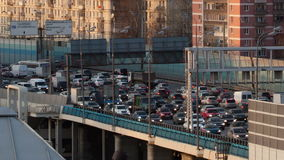 Time lapse traffic congestion on an urban flyover. During rush hour traffic as cars drive nose to tail in the early evening as commuters return home stock video