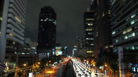 Time-lapse Traffic jam along the avenue in the business district at night.  stock video footage