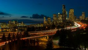 Time lapse of traffic light trails on freeway in Seattle WA at sunset into night stock footage