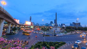 Time lapse of  traffic light at Victory monument public landmark in Bangkok stock video