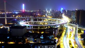 Time lapse of traffic lights trail & vehicles on overpass bridge at night. Timelapse of driving & cars racing with streaking lights trail on overpass bridge at stock footage