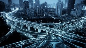 Time lapse,traffic lights trail & vehicles on Overpass interchange at night. stock video footage