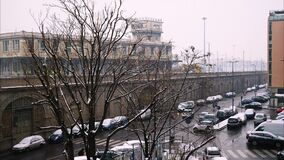 Time lapse of traffic in Milan with snow near the train station during snowfall. Time lapse of traffic in Milan with snow near the train station during a stock video footage