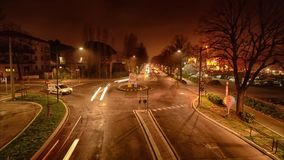 Time lapse of traffic in roundabout. At night stock video footage