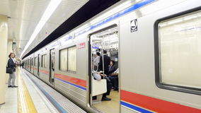 Time Lapse of Train Entering Subway Station at Busy Tokyo Metrorail System. Busy Metro Rail Station in Tokyo stock footage