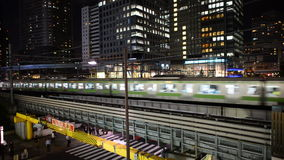 Time Lapse of Train Passing over Bridge in Central Tokyo Japan at Night. Japan Rail Train Passes By stock footage