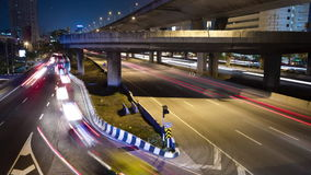 Time lapse,transport,traffic. Busy traffic under the expressway at night in Bangkok city, Thailand stock video