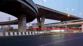 Time lapse,transport,traffic. Busy traffic under the expressway at night in Bangkok city, Thailand stock footage