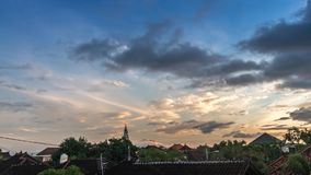 Time-lapse tropical sunrise overlooking the roofs of balinese traditional houses. Tropical Bali time lapse, Indonesia. Time-lapse tropical sunrise overlooking stock video