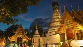 Time lapse twilight  Pra Singha Temple zoom out stock video footage