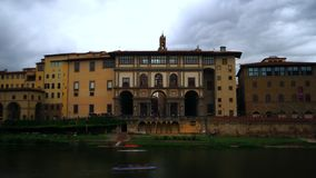 Time lapse of Uffizi Gallery, Florence. Florence, October 2017: Time lapse of facade on the River Arno of the Uffizi Gallery. The day is windy with clouds. On stock video footage