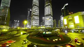 Time lapse urban traffic at night,Brightly lit shanghai pudong building. stock video footage