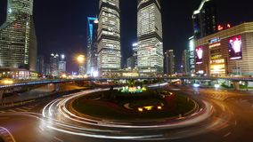 Time lapse urban traffic at night,Brightly lit shanghai pudong building. stock footage