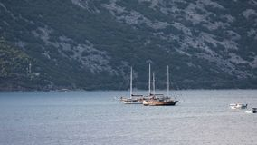 Time lapse of various boats  in the Bay of Kotor. With seaside in the background stock video footage
