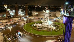 Fira de Barcelona Square Crowd at Night. Time Lapse vehicles and pedestrians in the Plaza Spain in Fira de Barcelona stock footage