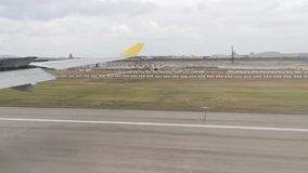 Time lapse video of airplane landing view from window in Changi International Airport stock footage