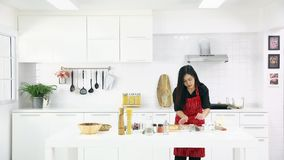 Asian woman teaching daughterkitchen. Time lapse video, beautiful Asian woman in red shirt and black apron teaching her daughter how to arrange things for stock video