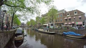 Amsterdam canals. Time lapse video of a canal in Amsterdam, Netherlands stock video