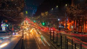 Time lapse video of cars with a long exposure at night in Yerevan on street Mashtots. The camera is approaching. Time lapse video of cars with a long exposure stock video footage