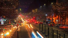 Time lapse video of cars with a long exposure at night in Yerevan on street Mashtots. The camera moves away. Time lapse video of cars with a long exposure at stock video