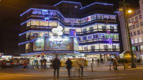 Time lapse video of christmas markets in front of a large decorated shopping center Kotva in Prague on the Republic square.8403 stock footage