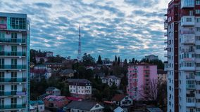 Time-lapse video of day to night transition. With aerial view of the apartment district of the city of Sochi, Russia stock video footage