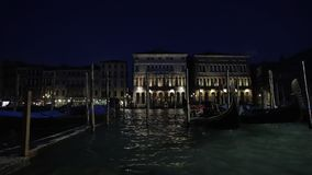 The Grand Canal in Venice, Italy. A time lapse video of the Grand Canal in Venice, Italy during the evening time. Boats and gondolas can be seen passing along stock video footage