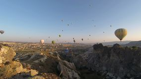 Time-lapse video of hot air balloons stock footage