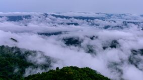 Time lapse video 4K, Morning mist over the mountain above Doi Pha sam Liam, Mae tang, Chiang mai, Thailand