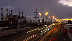 Time lapse video of night traffic on urban thoroughfare along industrial zone stock footage