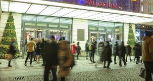 Time lapse video of people coming in and out from the large decorated shopping center Palladium in Prague, 4096p, 24fps stock video