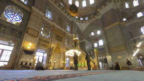 Time Lapse video of people inside a mosque in Istanbul Turkey. ISTANBUL, TURKEY - DECEMBER 18, 2014: Time lapse video of people inside Dolmabahce Mosque in stock video