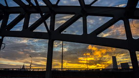 Time lapse video of steel bridge with clouds running on background. In sunset stock video footage